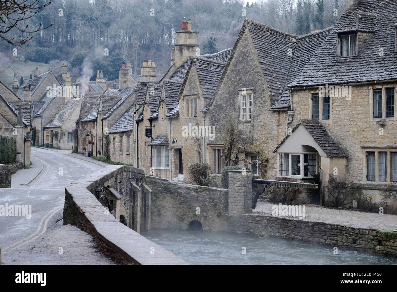 Castle Combe, Wiltshire, UK. 1st Jan, 2021. Mist on the river on a frosty New Year's Day in the historic village of Castle Combe. Credit: JMF News/Alamy Live News Stock Photo