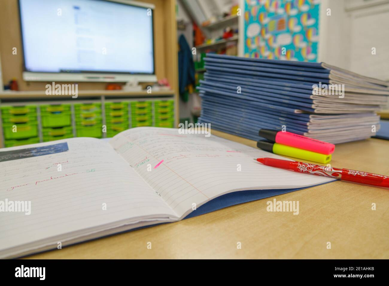 pile-of-school-books-on-a-desk-that-a-te