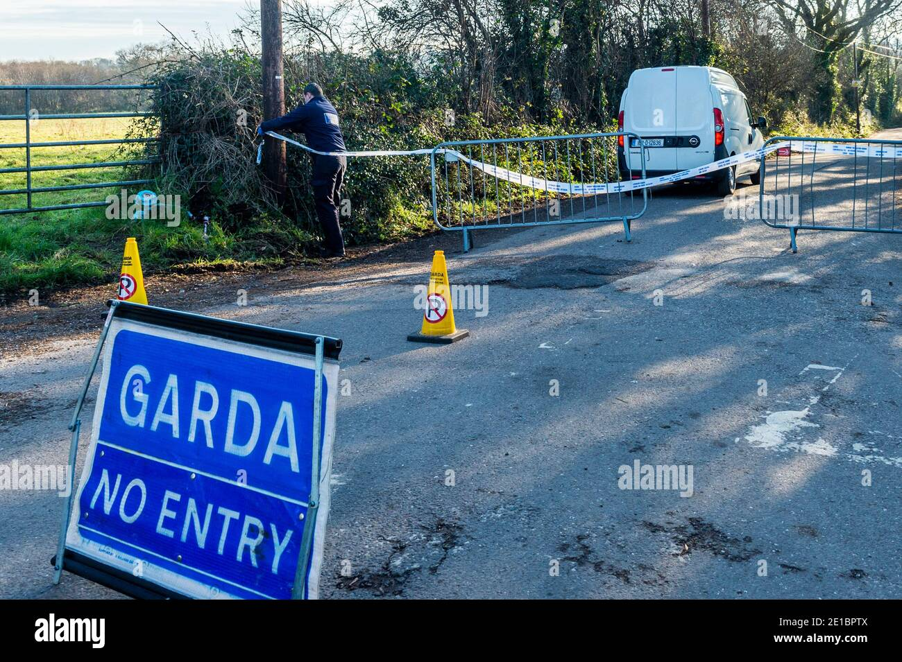 midleton-county-cork-ireland-6th-jan-2021-skeletal-remains-were-found-on-the-midleton-to-youghal-greenway-last-night-just-outside-midleton-gardai-have-the-road-leading-to-the-discovery-sealed-off-a-garda-forensics-officer-arrives-at-the-scene-the-pathologist-is-due-to-examine-the-remains-this-afternoon-credit-ag-newsalamy-live-news-2E1BPTX.jpg