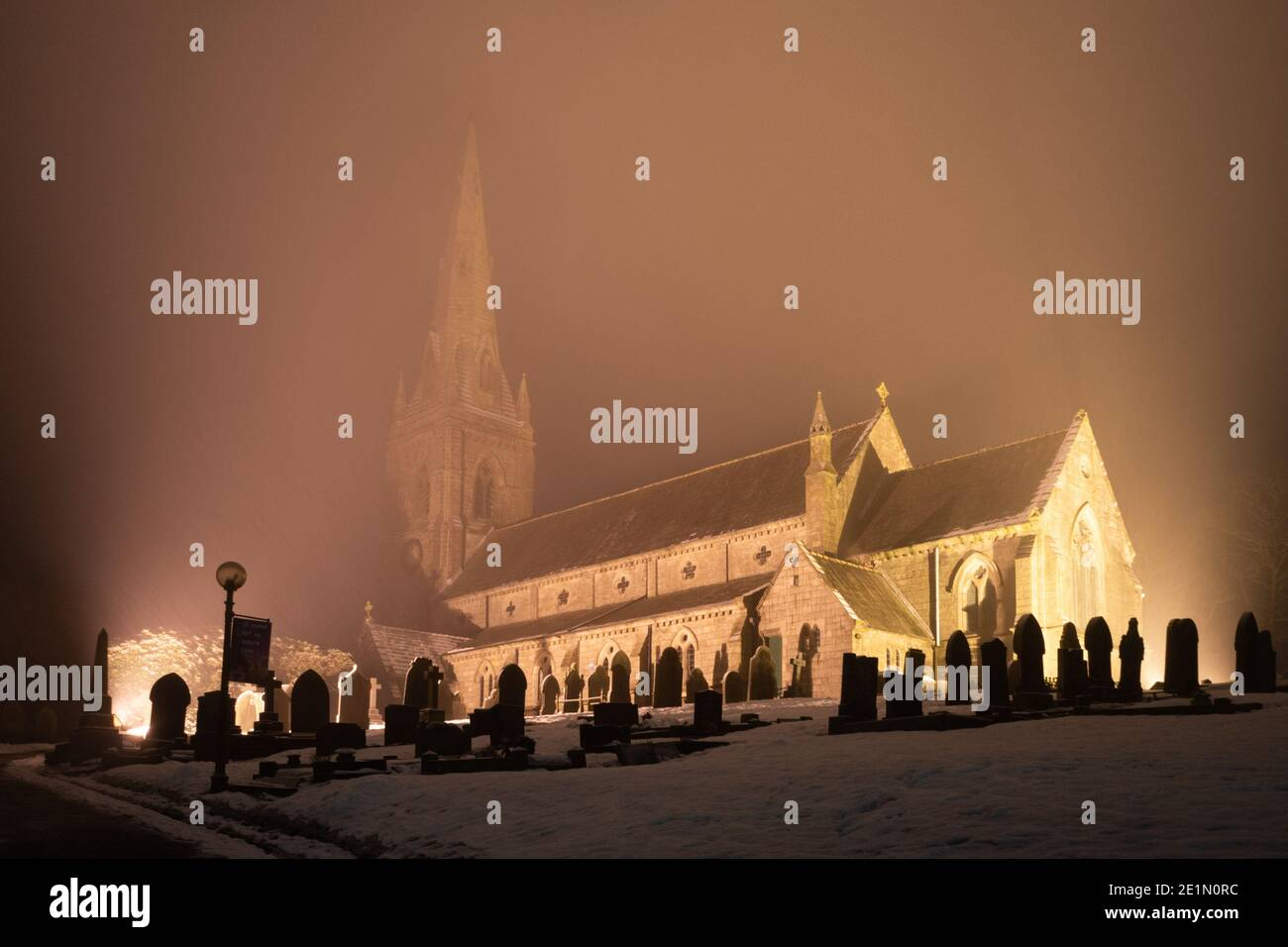 St Peter's Church, Belmont, Lancashire, England, UK. Church of England, Diocese of Manchester. Church grounds illuminated at night in snow Stock Photo