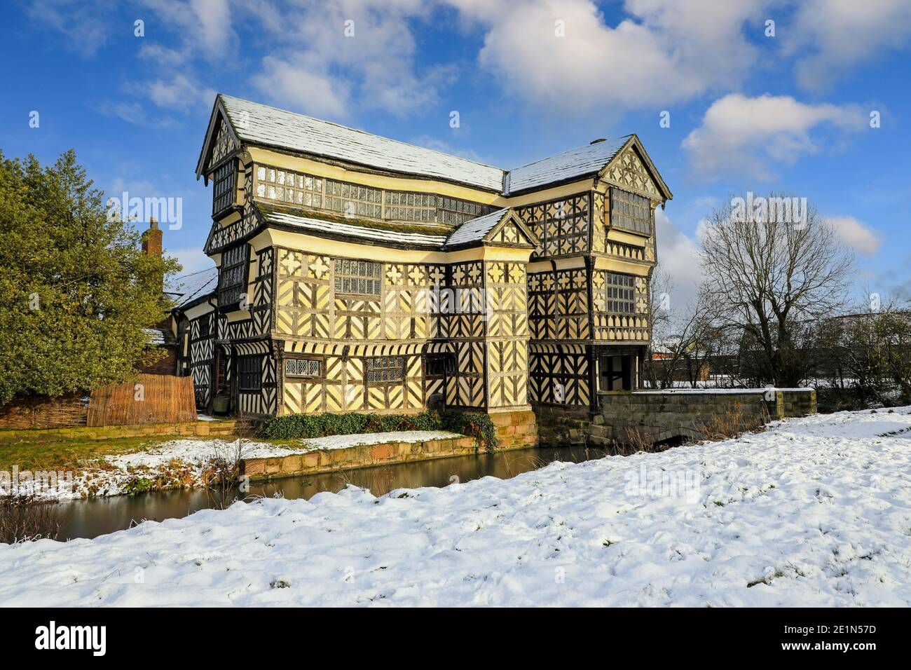 little-moreton-hall-cheshire-moated-15th-century-half-timbered-manor-house-in-the-snow-winter-2020-december-photo-taken-from-public-footpath-2E1N57D.jpg