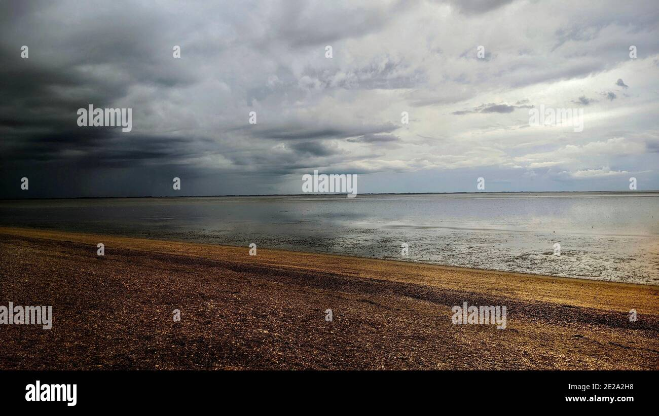 dark-grey-storm-clouds-gather-on-a-pebbl