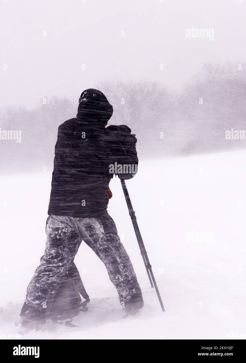 A photographer working, taking photos during a blizzard on the Plains of Abraham, Quebec City, Stock Photo
