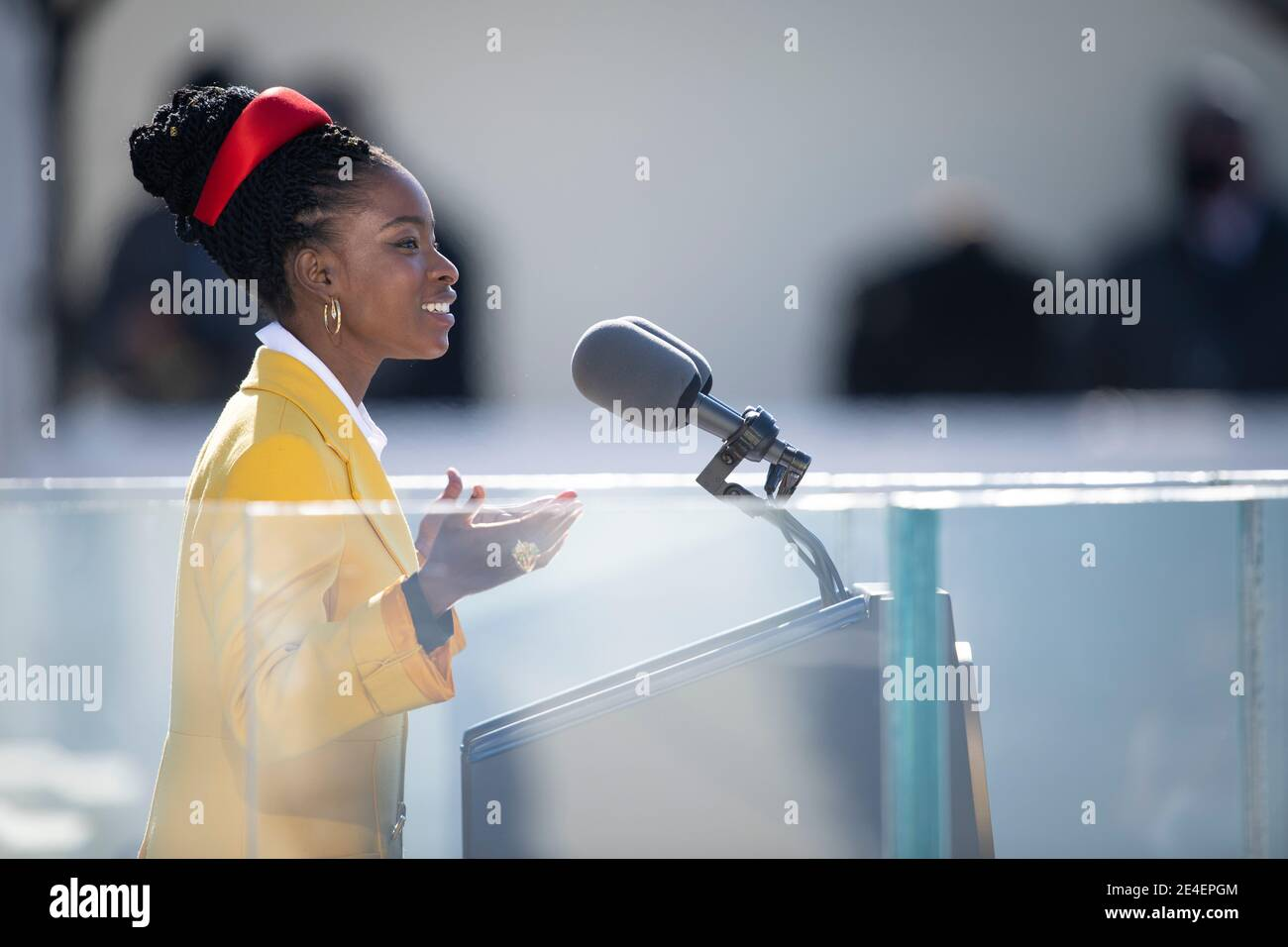Washington, United States Of America. 20th Jan, 2021. Amanda Gorman recites her inaugural poem; The Hill We Climb, during the 59th Presidential Inauguration ceremony at the West Front of the U.S. Capitol January 20, 2021 in Washington, DC Credit: Planetpix/Alamy Live News Stock Photo