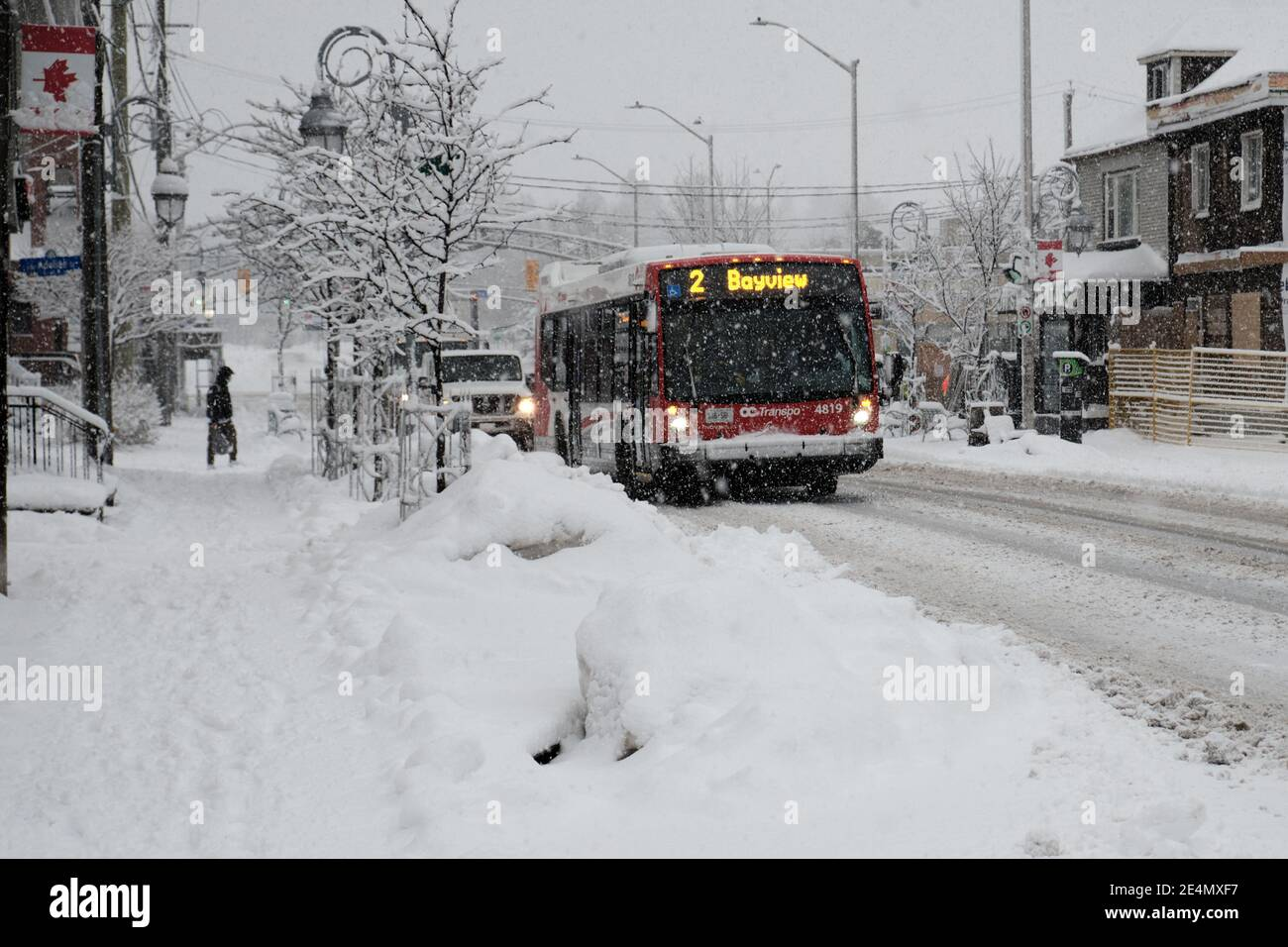 On Ottawa public bus No. 2 on a city street with heavy snow falling during a winter storm Stock Photo