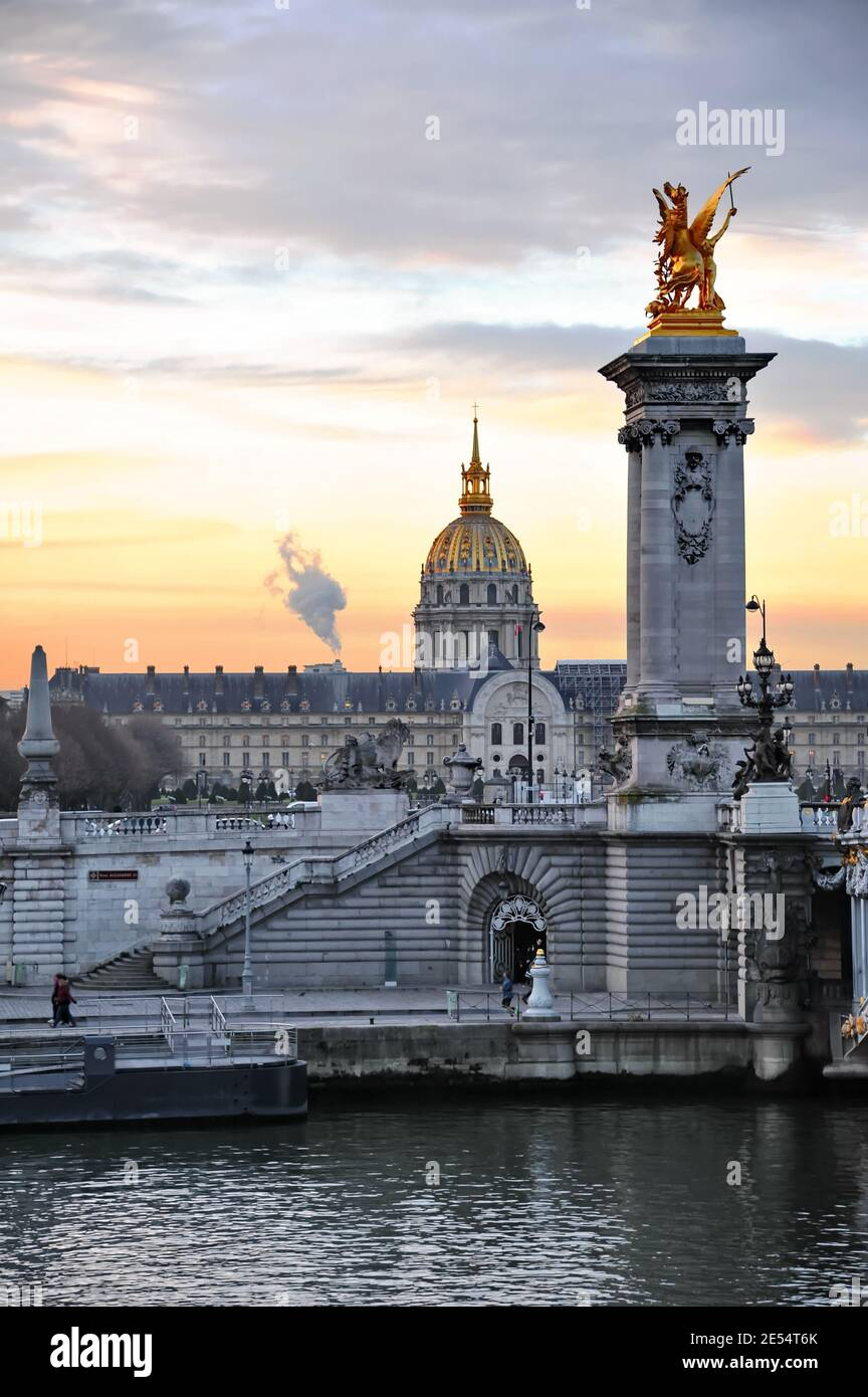 View to Invalides church from Alexander III Bridge in Paris, France Stock Photo