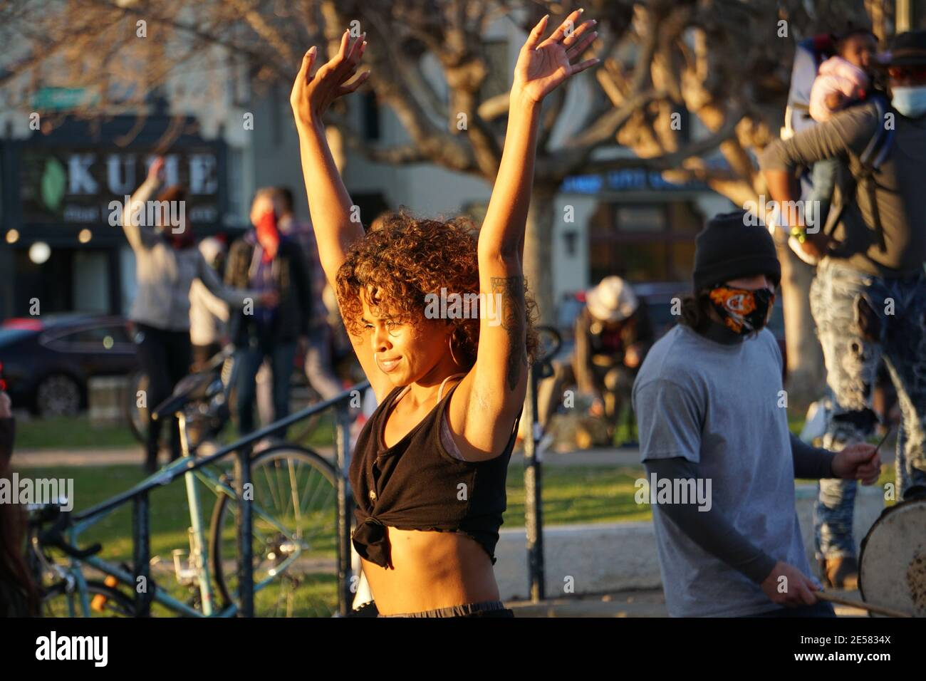 Dancers in the community drum circle on a Saturday afternoon at Lake Merritt. Oakland, California, USA Stock Photo