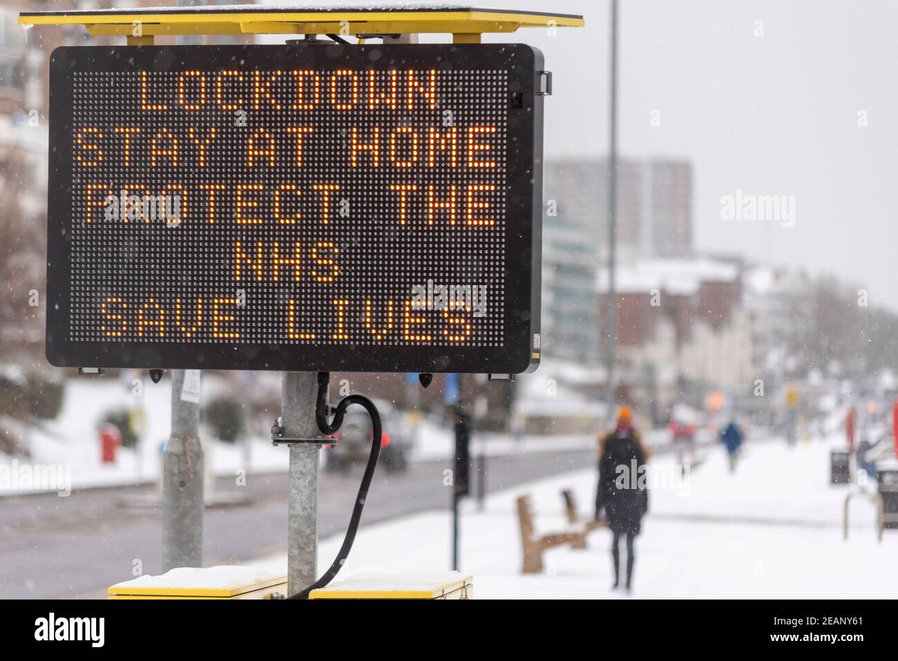 matrix-sign-warning-of-covid-19-lockdown-measures-in-southend-on-sea-essex-uk-with-snow-from-storm-darcy-stay-at-home-protect-the-nhs-slogan-2EANY61.jpg