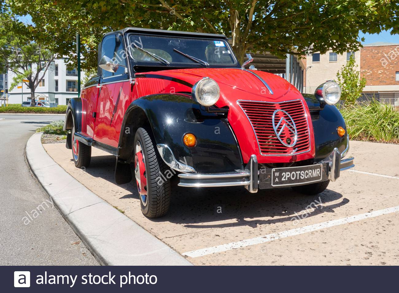 a-red-and-black-vintage-citroen-2cv-car-2EAYRWR.jpg