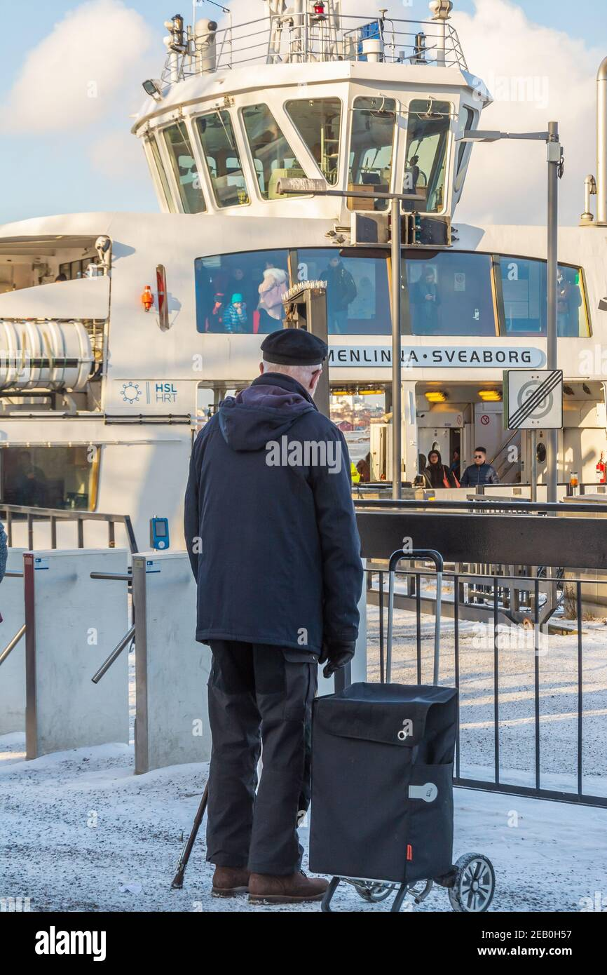 elderly-man-waiting-tje-suomenlinna-ferry-at-market-palce-in-helsinki-finland-2EB0H57.jpg