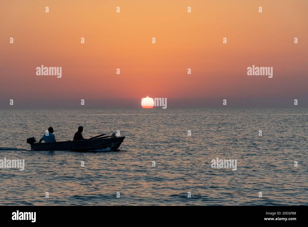 landscape - sunset on the coast, waves, horizon. top view. Stock Photo