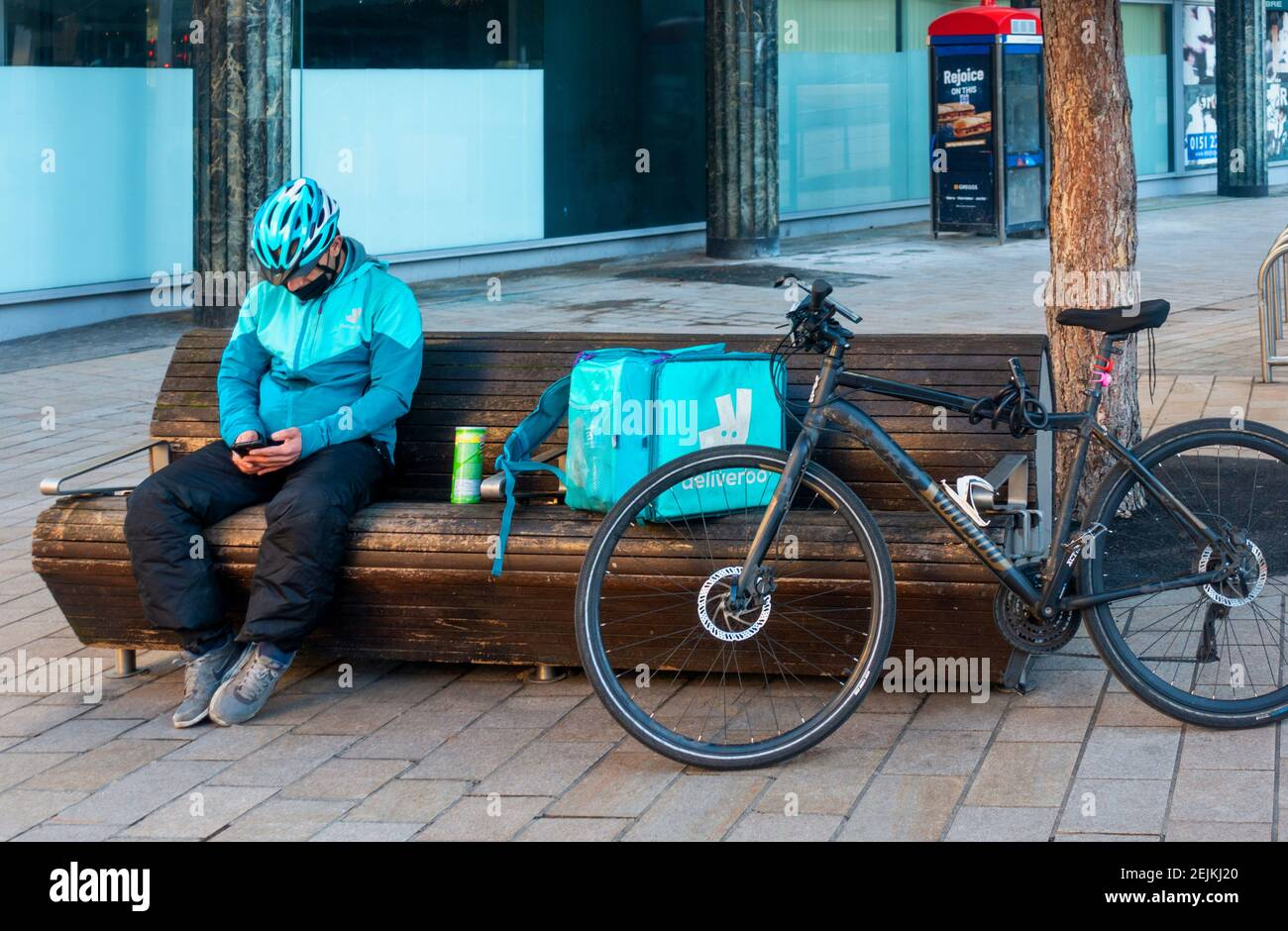 deliveroo-bike-delivery-man-checking-his