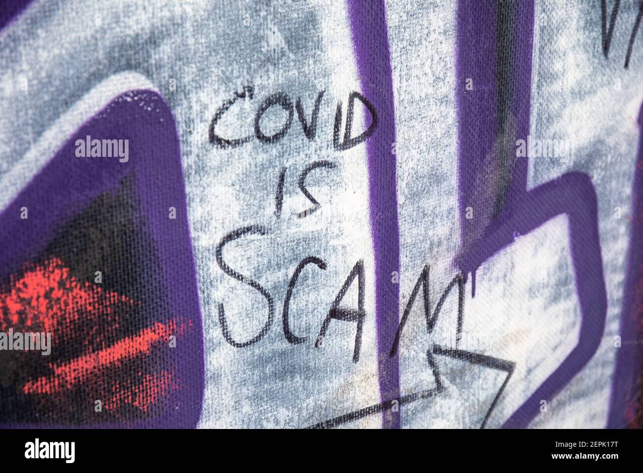 covid-is-scam-conspiracy-theory-writing-