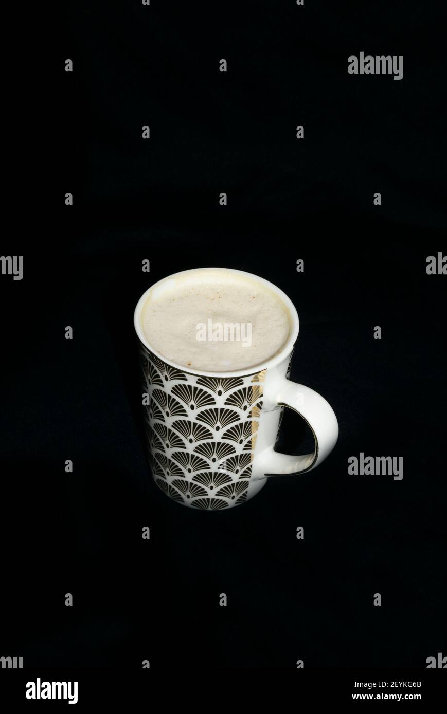 frothy-coffee-in-mug-with-art-deco-design-2EYKG6B.jpg