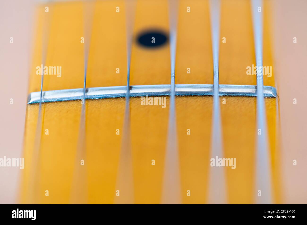 a-macro-closeup-of-strings-and-a-fret-on
