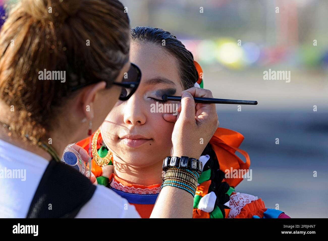 a-young-latina-participant-in-the-mexican-section-getting-ready-for-the-calgary-stampede-parade-to-start-2F0JHN7.jpg