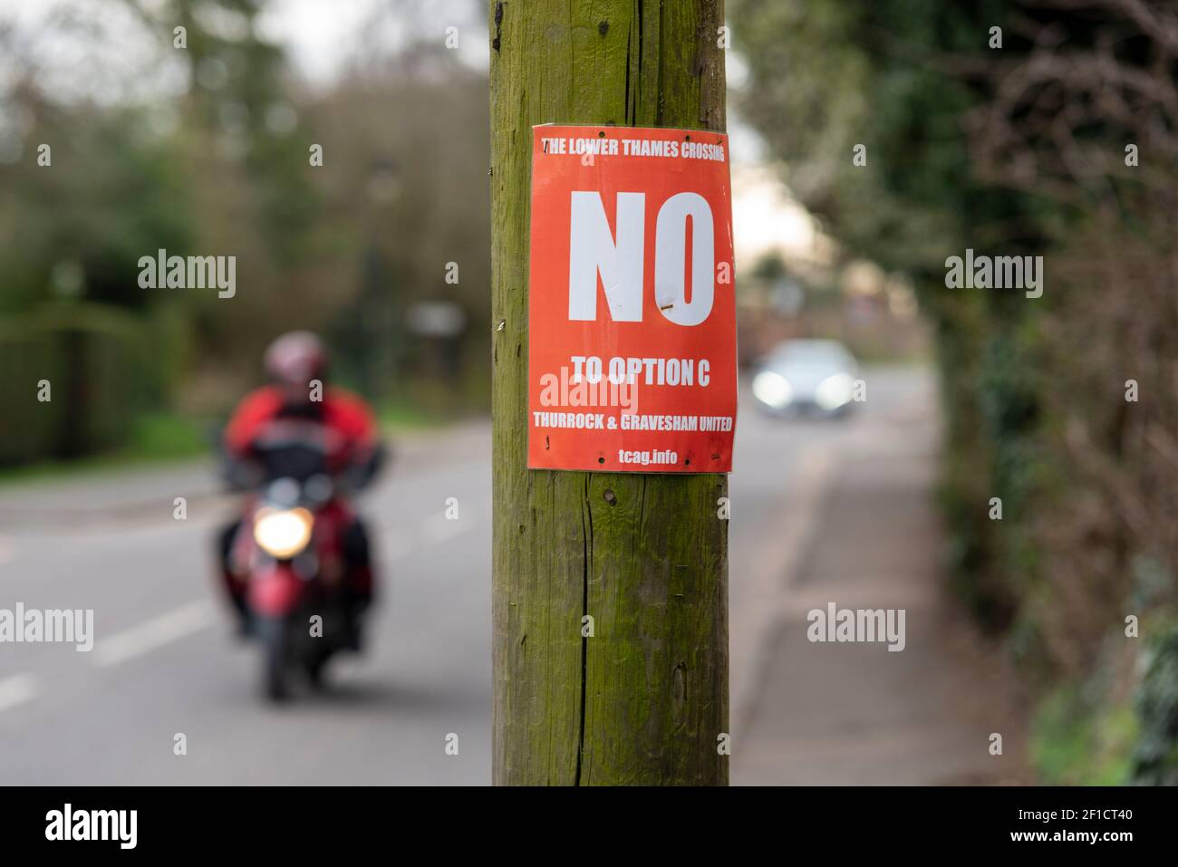 lower-thames-crossing-road-development-protest-poster-in-orsett-essex-uk-opposing-option-c-which-is-planned-to-pass-close-by-the-village-2F1CT40.jpg