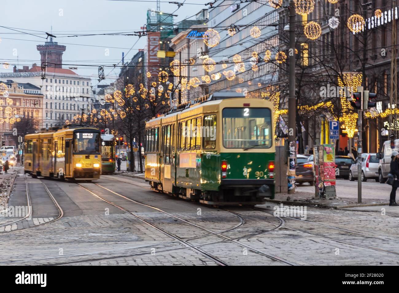Trams at Mannerheimintie street in the evening in Helsinki Finland Stock Photo