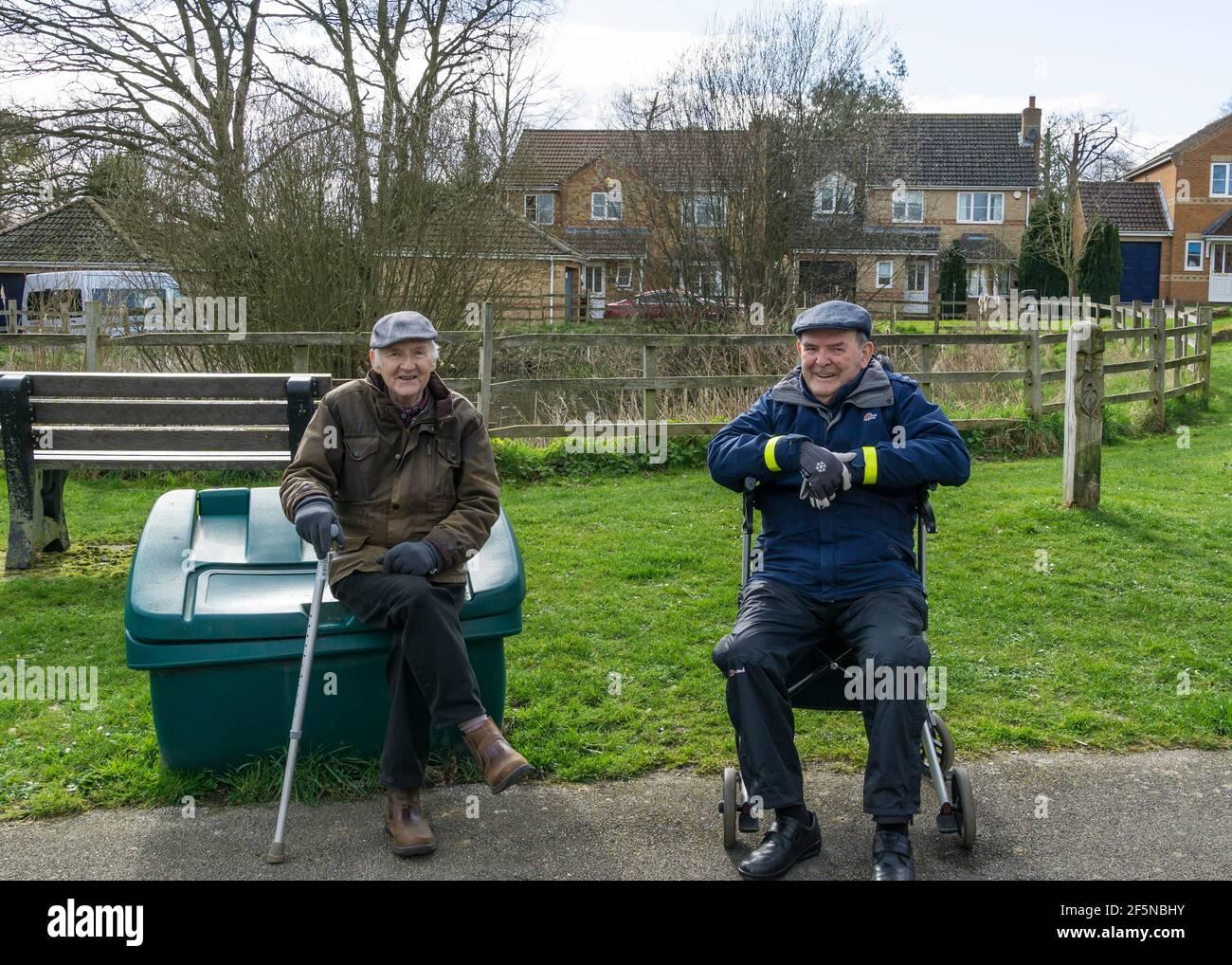 Two retired gentlemen having a breath of fresh air. Stock Photo