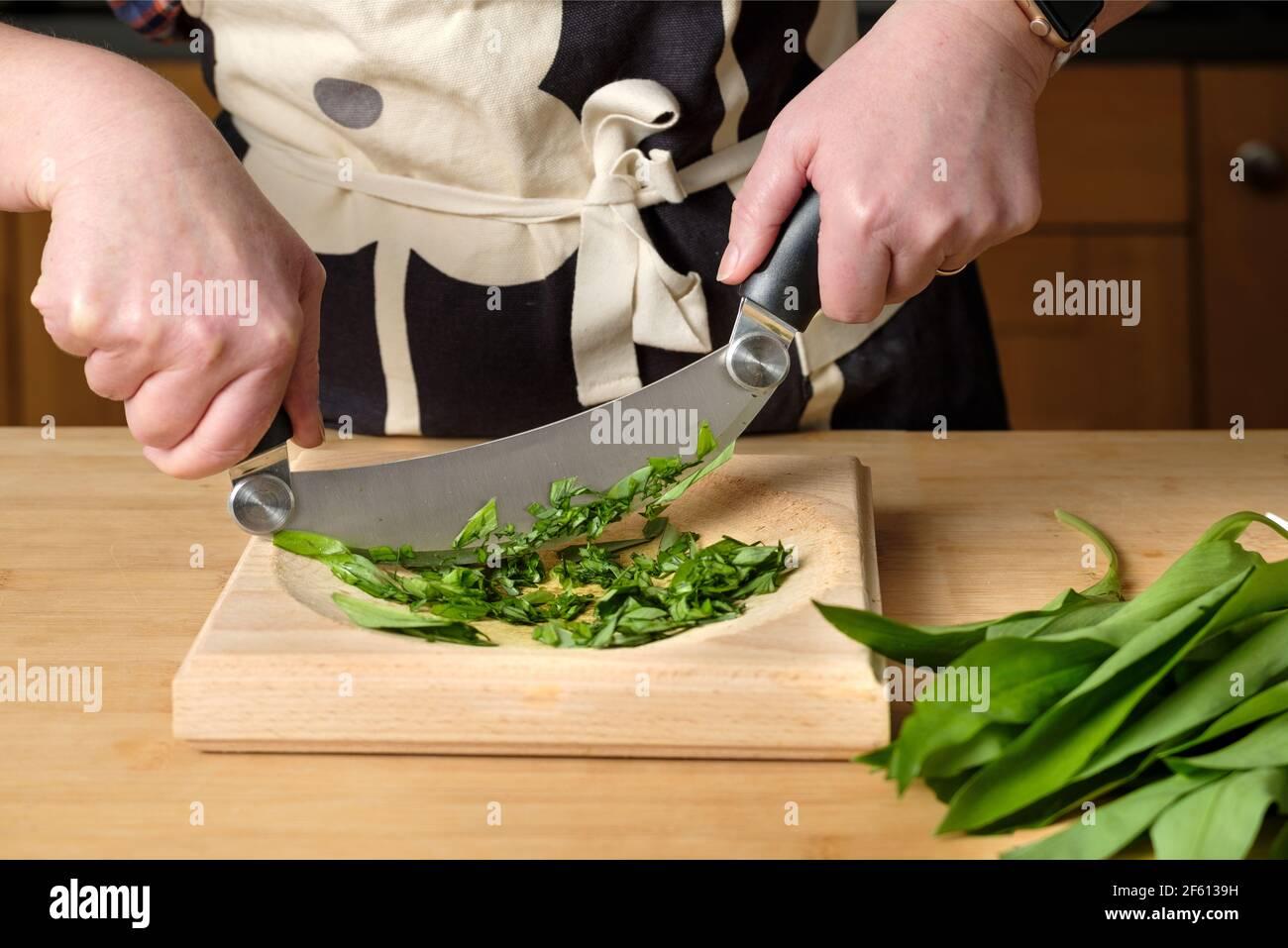 a-cook-chops-freshly-picked-wild-garlic-