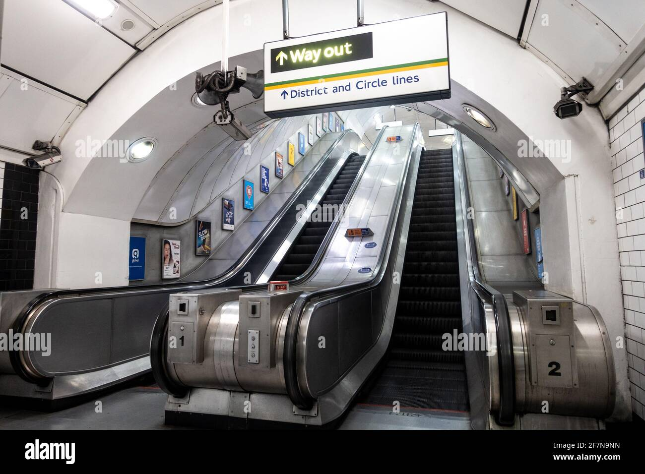 escalators-at-a-london-underground-station-are-empty-due-to-coronavirus-stopping-people-from-traveling-2F7N9NN.jpg
