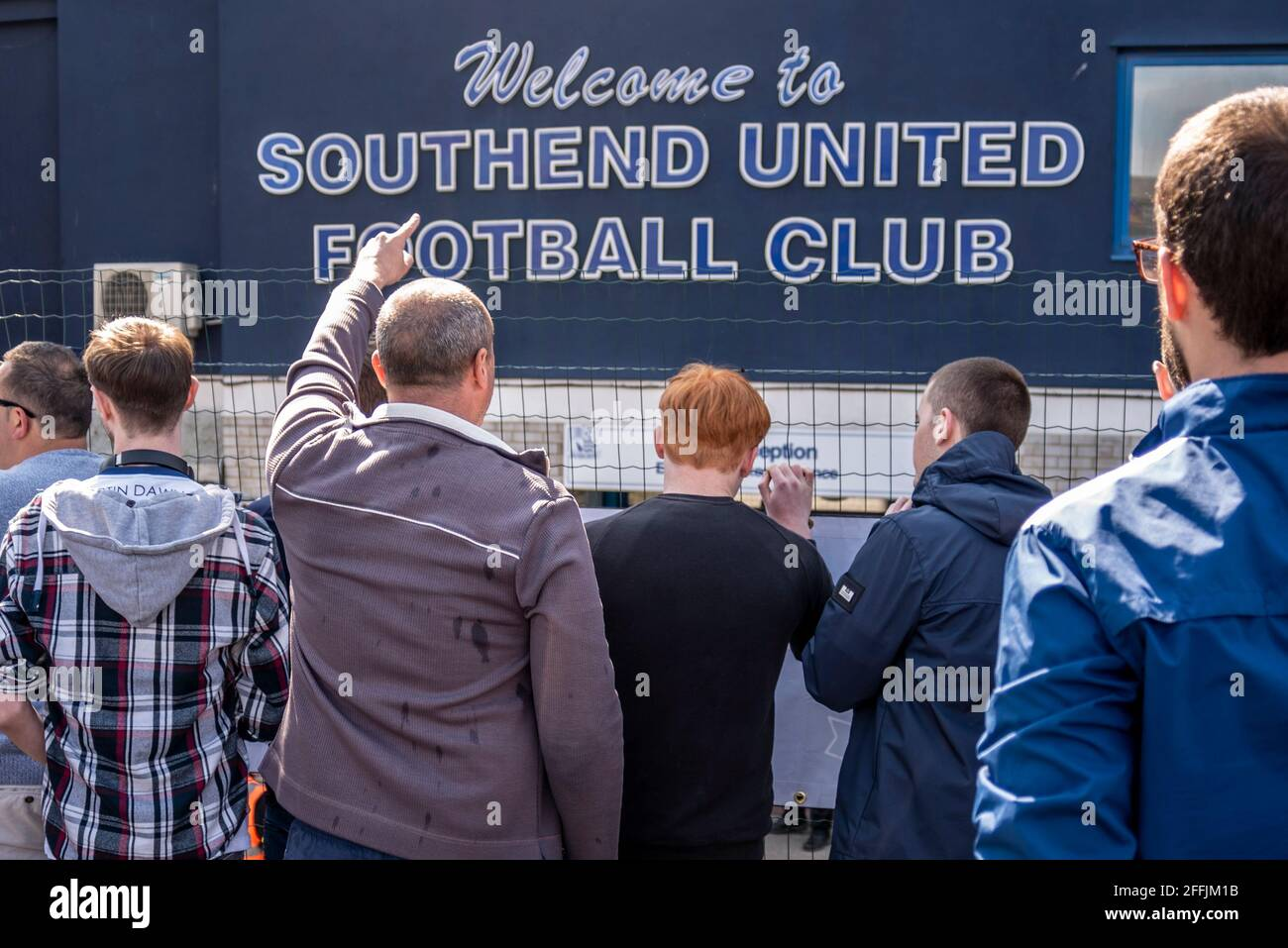 supporters-at-a-protest-against-the-chairman-ron-martin-outside-the-roots-hall-stadium-of-southend-utd-football-club-essex-uk-chanting-2FFJM1B.jpg