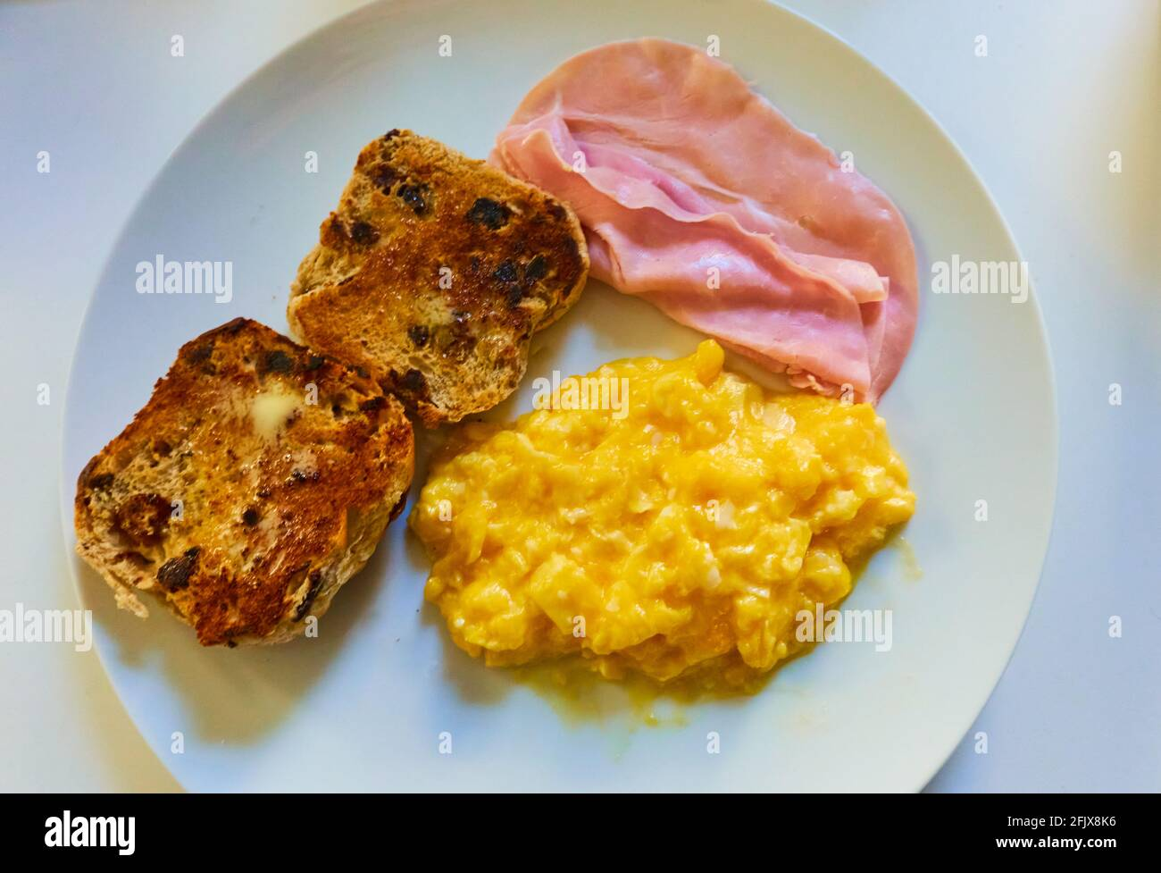 scrambled-eggs-with-ham-and-a-toasted-ho