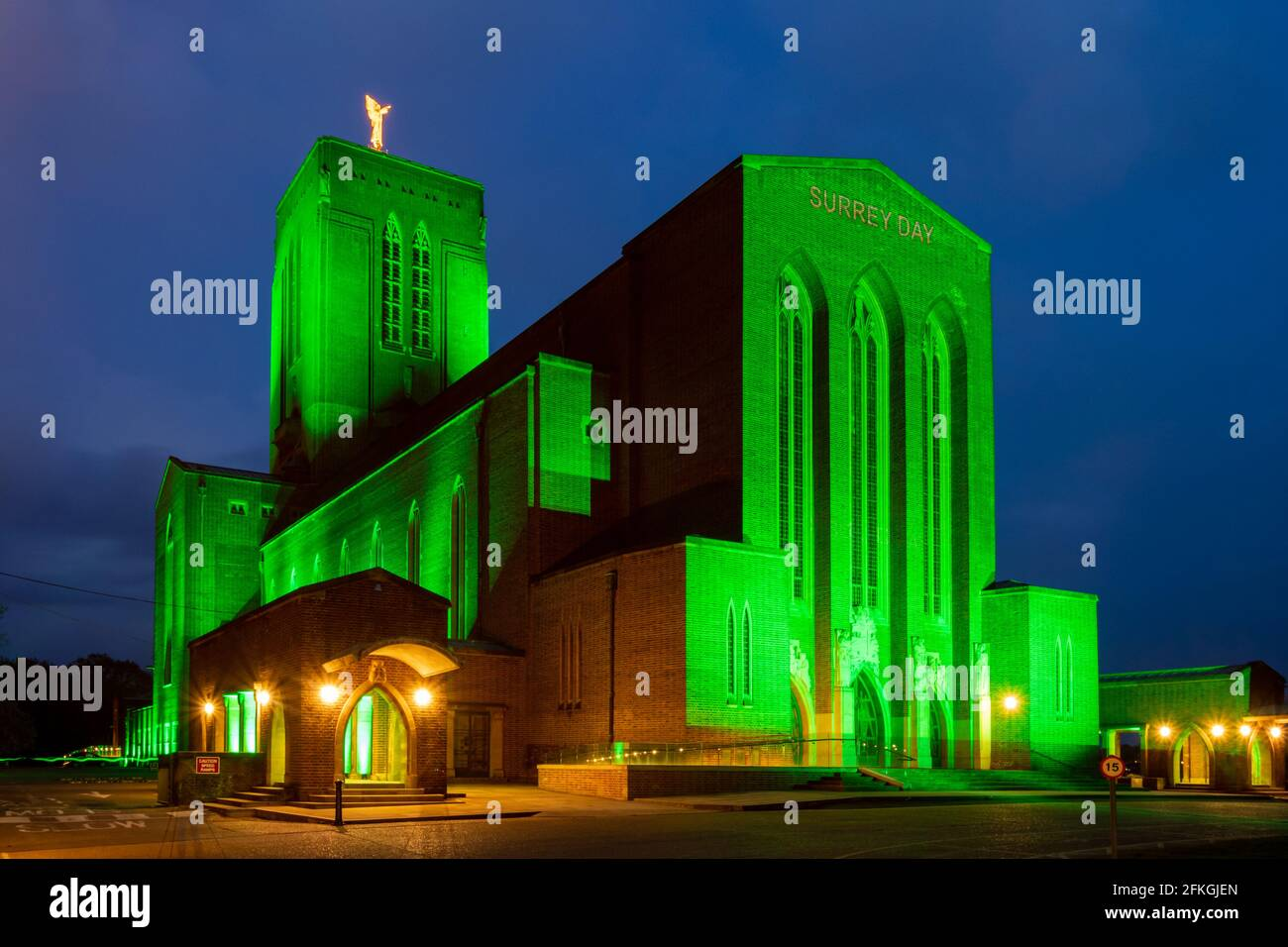 may-1st-2021-today-the-third-annual-surrey-day-was-held-with-various-events-and-celebrations-some-virtual-taking-place-in-the-evening-guildford-cathedral-was-illuminated-in-green-light-in-recognition-of-surrey-being-englands-most-densely-wooded-county-and-the-words-surrey-day-were-projected-onto-the-front-2FKGJEN.jpg
