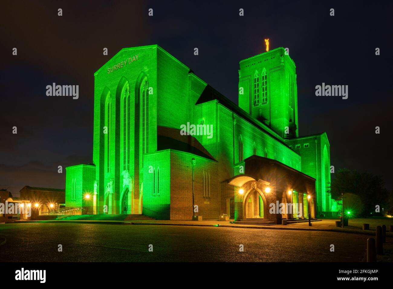 may-1st-2021-today-the-third-annual-surrey-day-was-held-with-various-events-and-celebrations-some-virtual-taking-place-in-the-evening-guildford-cathedral-was-illuminated-in-green-light-in-recognition-of-surrey-being-englands-most-densely-wooded-county-and-the-words-surrey-day-were-projected-onto-the-front-2FKGJMP.jpg