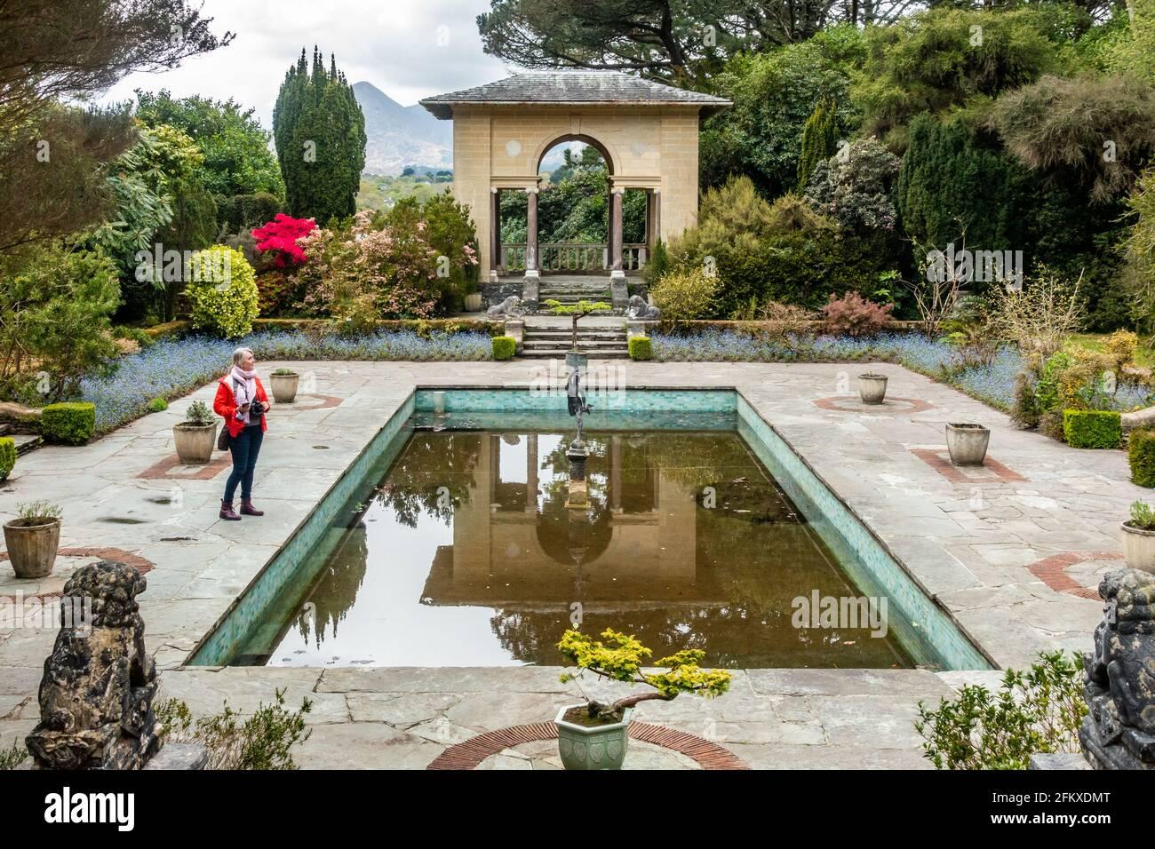 woman-looks-around-the-italian-garden-on-garinish-island-west-cork-ireland-2FKXDMT.jpg