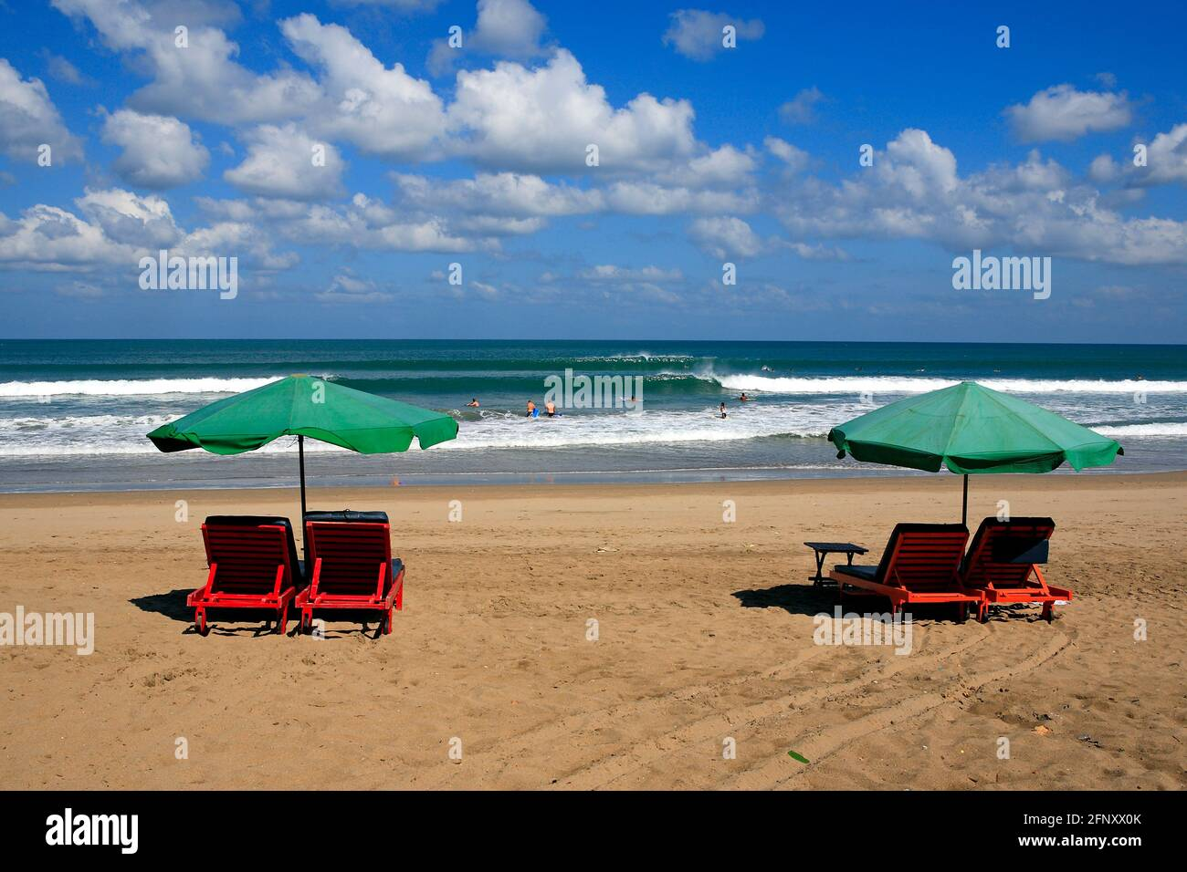 beach-chairs-with-umbrellas-kuta-legian-beach-bali-indonesia-2FNXX0K.jpg