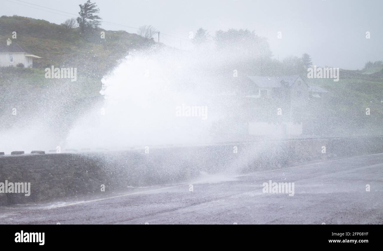 tragumna-west-cork-ireland-thursday-20th-may-2021-storm-force-winds-overnight-and-today-with-speeds-up-to-110kph-sent-huge-waves-battering-the-sea-defence-wall-along-the-coast-road-at-tragumnawest-cork-today-credit-aphperspective-alamy-live-news-2FP08YF.jpg