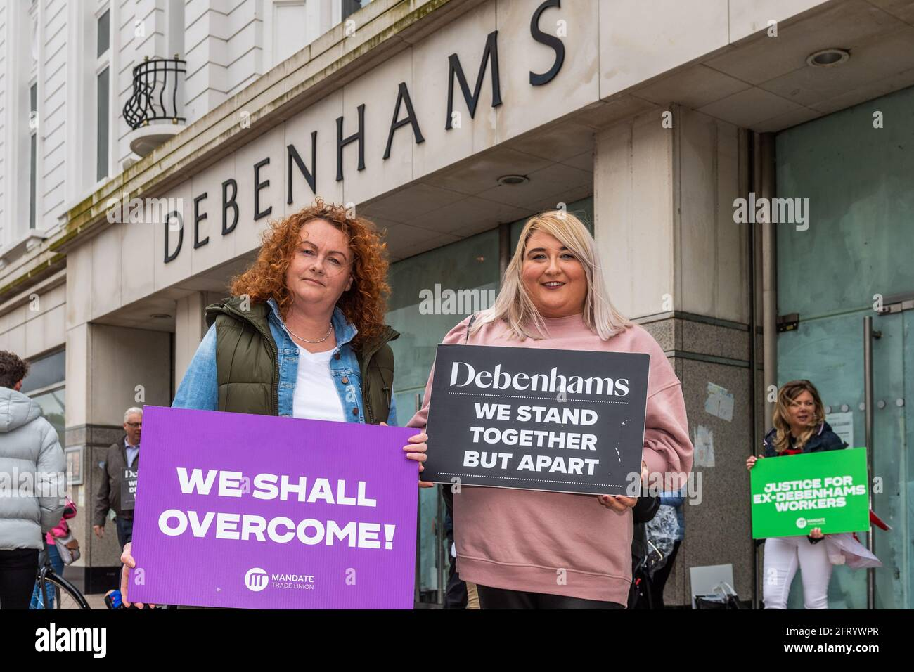 cork-ireland-21st-may-2021-after-406-days-outside-debenhams-patrick-street-cork-store-ex-workers-have-called-off-their-protest-the-ex-debenhams-staff-were-protesting-to-receive-their-full-redundancy-entitlement-but-were-offered-a-3m-upskilling-package-which-they-accepted-with-a-majority-vote-yesterday-pictured-are-ex-workers-gillian-mcsweeney-and-gemma-jones-credit-ag-newsalamy-live-news-2FRYWPR.jpg