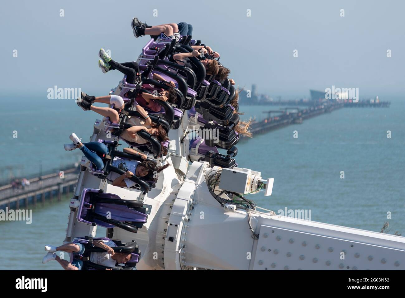 southend-on-sea-essex-uk-31st-may-2021-the-warm-sunny-weather-has-attracted-people-to-the-seaside-town-on-the-bank-holiday-monday-the-axis-thrill-ride-in-adventure-island-pleasure-park-has-been-popular-with-views-of-southend-pier-stretching-out-into-the-thames-estuary-2G03N52.jpg