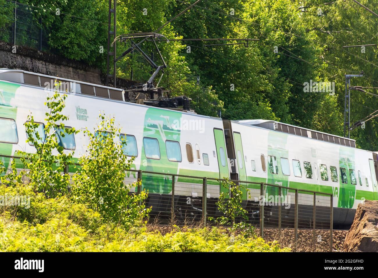 Passenger train on a ironn bridge in Tampere Finland Stock Photo