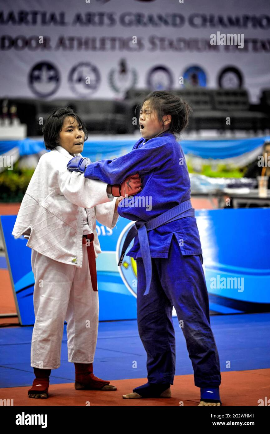 judo-female-competitors-with-woman-in-pa