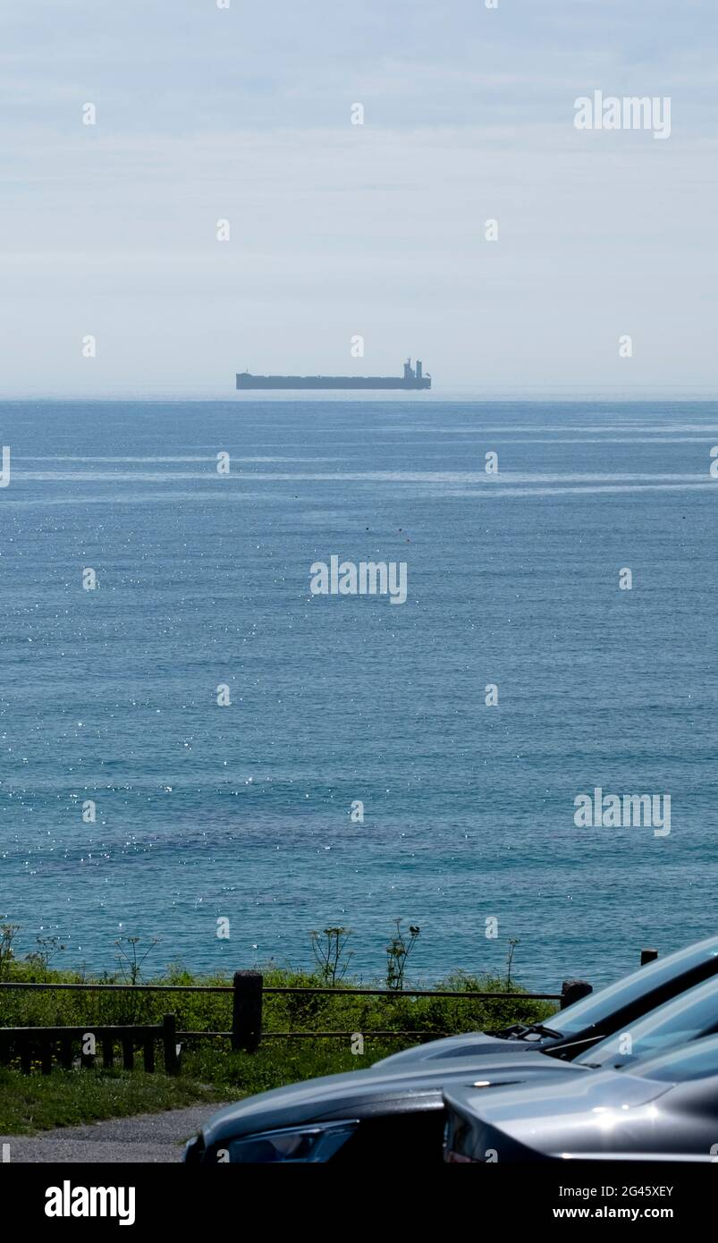 coverack-cornwall-uk-19th-june-2021-sunny-weather-and-ideal-conditions-create-the-optical-illusion-of-a-flying-ship-seen-off-the-cornish-coast-near-coverack-fishing-village-credit-jmf-newsalamy-live-news-2G45XEY.jpg