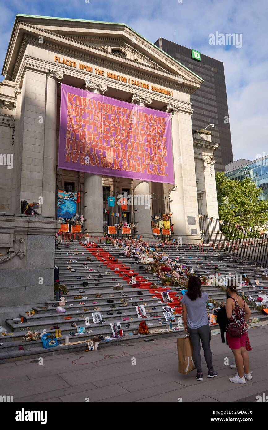 vancouver-british-columbia-canada-june-19-2021-haida-artist-tamara-bells-installation-of-215-pairs-of-shoes-on-the-steps-of-the-vancouver-art-gallery-has-become-a-makeshift-shrine-this-installation-honours-the-215-indigenous-children-whose-unmarked-graves-were-discovered-on-the-grounds-of-a-former-residential-school-in-kamloops-british-columbia-canada-2G4A876.jpg