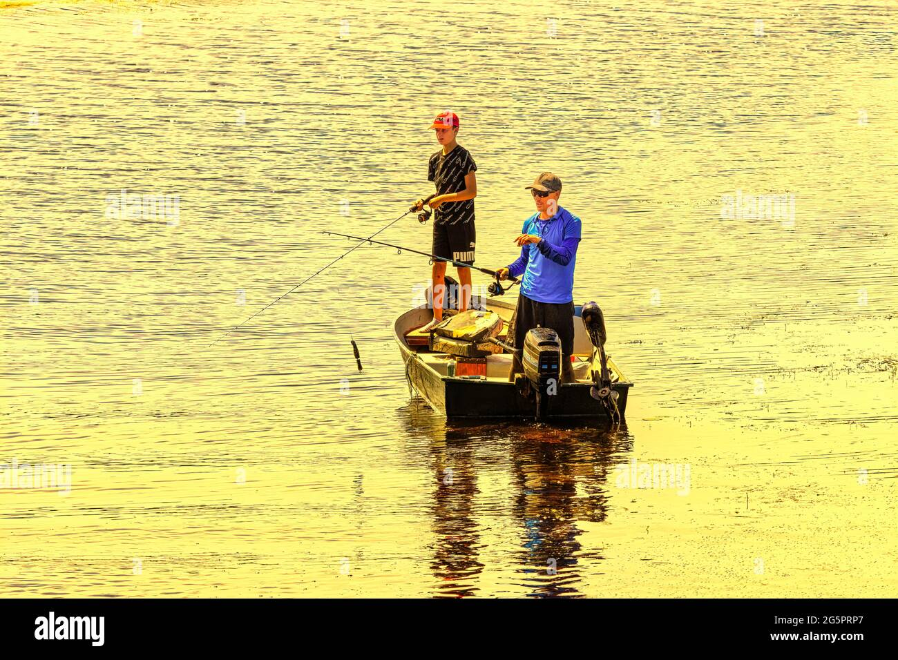 father-and-son-fly-fishing-from-a-boat-a
