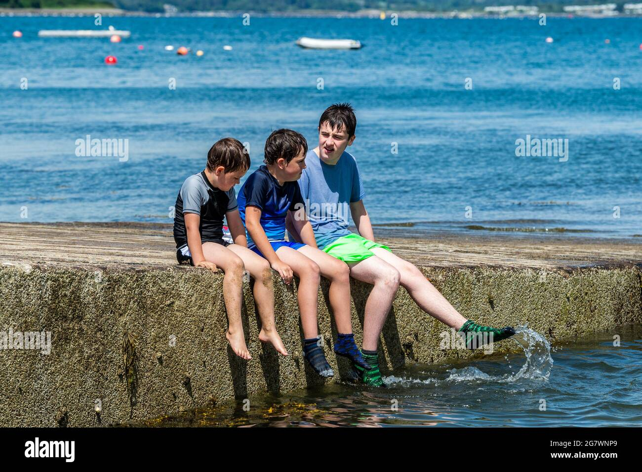 bantry-west-cork-ireland-16th-july-2021-the-sun-shone-on-bantry-in-west-cork-today-with-temperatures-hitting-25-degrees-with-even-hotter-weather-predicted-for-the-weekend-people-took-the-opportunity-to-cool-off-in-the-sea-at-abbey-beach-credit-ag-newsalamy-live-news-2G7WNP9.jpg