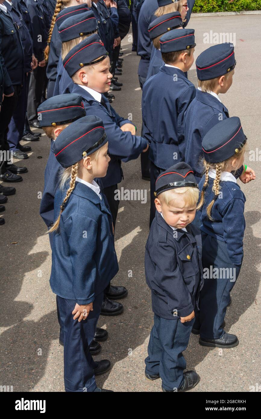 Young voluntary fire brigadeers in ubiforms at the celebration in Hollola Finland Stock Photo