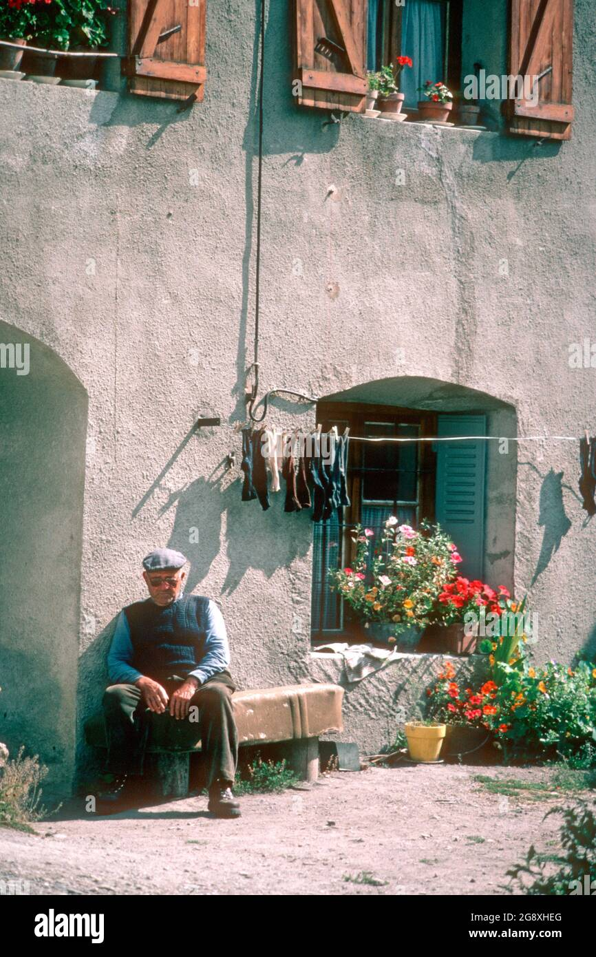 old-man-taking-a-nap-in-the-sun-in-1980-le-casset-hautes-alpes-france-2G8XHEG.jpg
