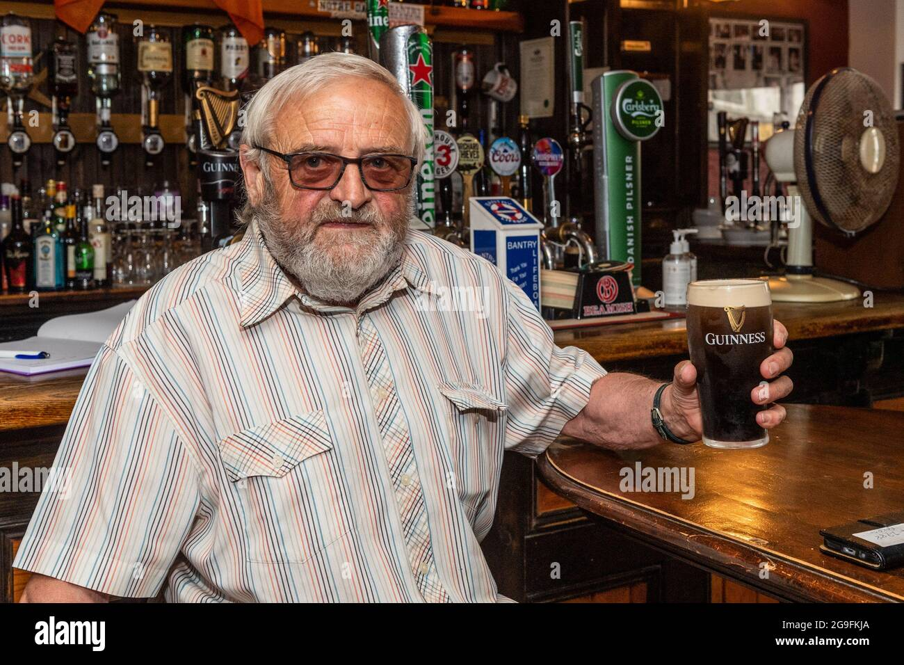 bantry-west-cork-ireland-26th-july-2021-today-the-so-called-wet-pubs-reopened-for-the-first-time-since-the-start-of-the-pandemic-first-customer-through-the-door-of-the-boston-bar-was-regular-eugene-hickey-from-bantry-credit-ag-newsalamy-live-news-2G9FKJA.jpg