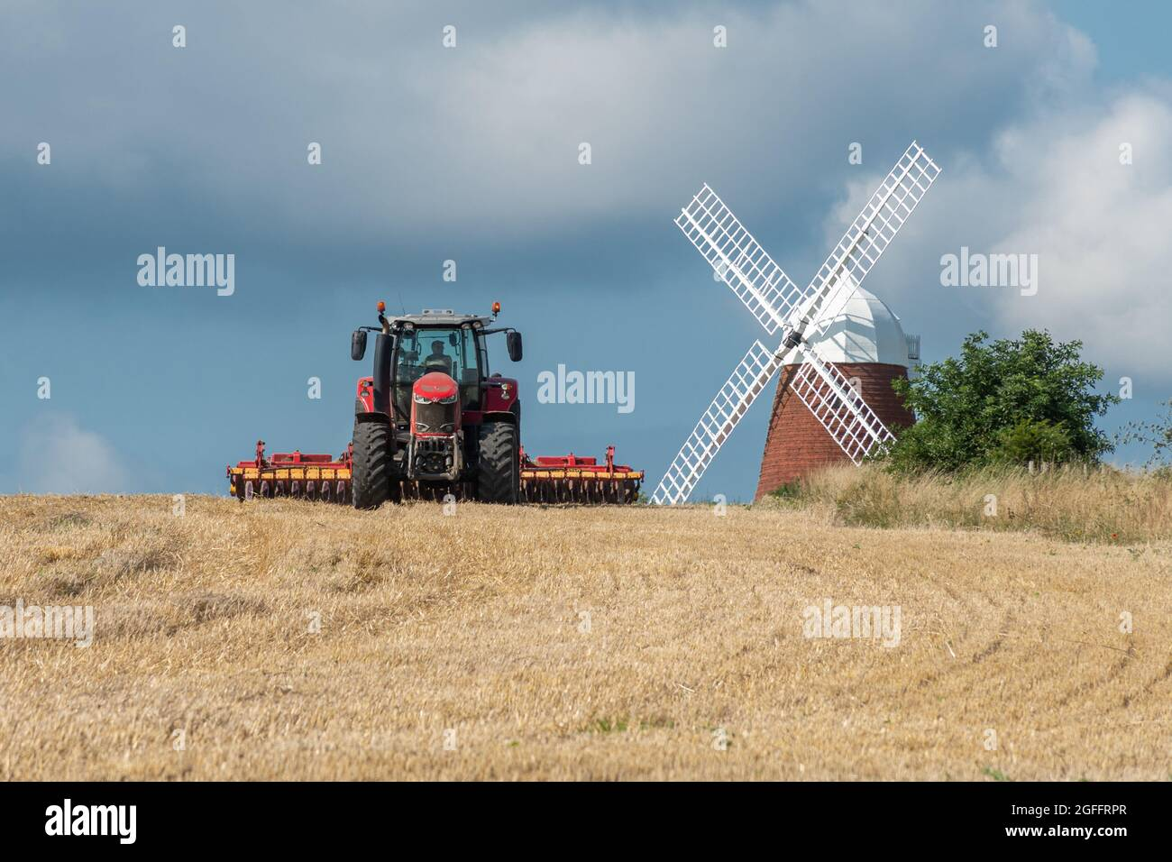 halnaker-windmill-in-the-south-downs-national-park-in-west-sussex-england-uk-with-a-red-tractor-working-in-the-cornfield-on-a-sunny-summer-day-2GFFRPR.jpg