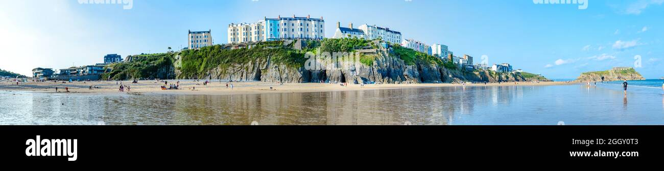 a-panoramic-view-of-the-south-beach-at-tenby-in-wales-uk-featuring-colourful-buildings-along-the-esplanade-on-the-cliff-above-2GGY0T3.jpg