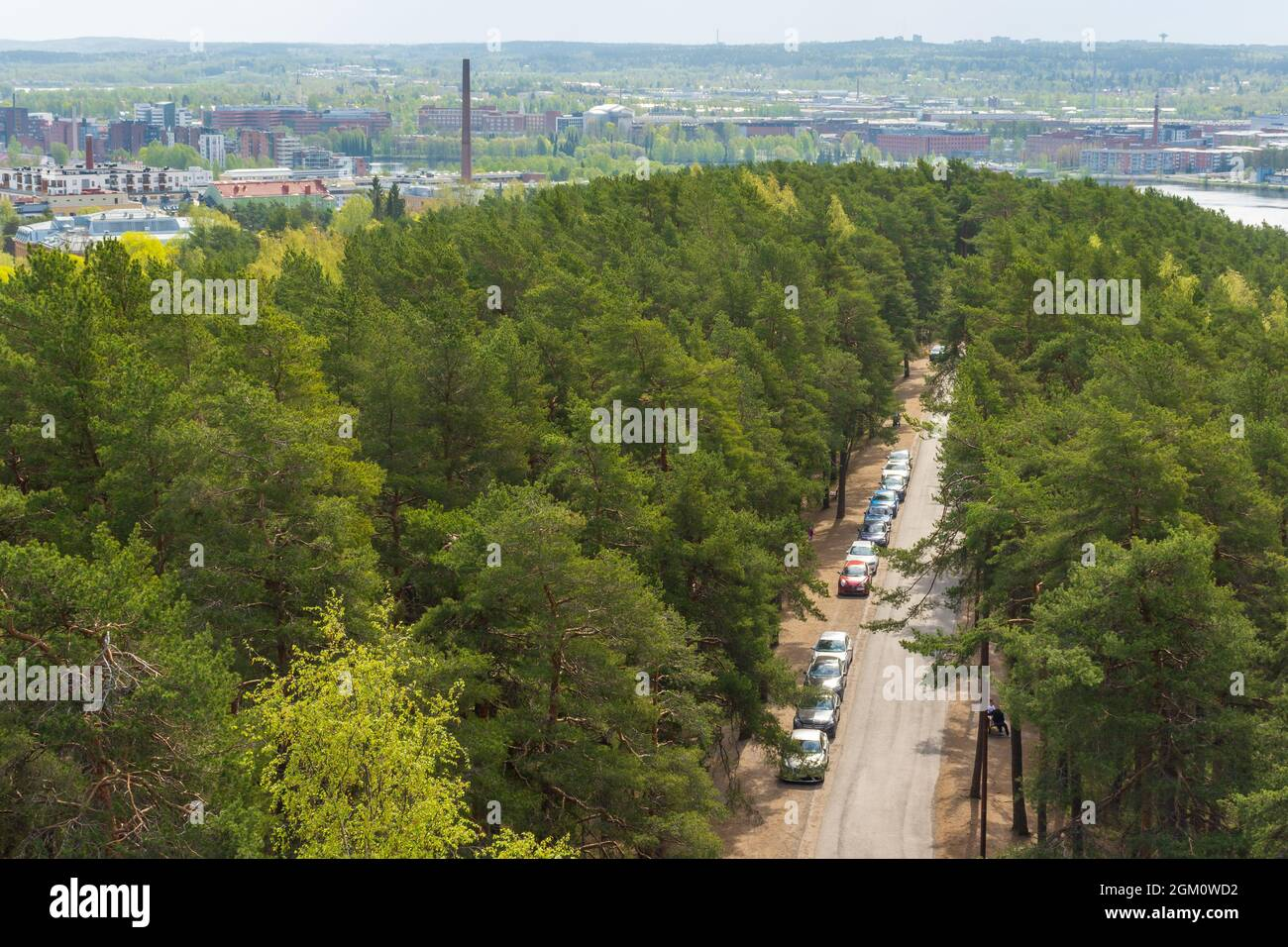 Parked cars by the side of gravel road to Pyynikki sightseeing tower in Tampere Finland Stock Photo