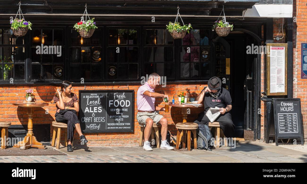 the-three-pigeons-pub-on-the-guildford-high-street-surrey-uk-with-people-sitting-enjoying-drinks-outside-on-a-sunny-day-2GMHA7H.jpg