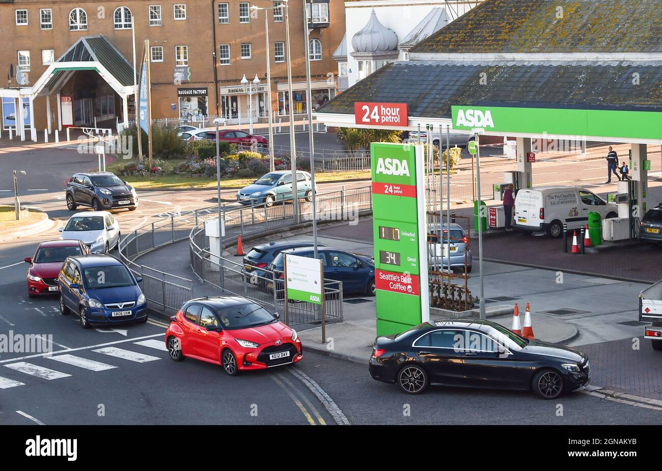 Brighton UK 24th September 2021 - Customers queue for fuel at a supermarket petrol station in Brighton this morning . Some BP and Shell petrol stations have had to temporarily close because of a shortage of truck drivers in the UK  : Credit Simon Dack / Alamy Live News Stock Photo