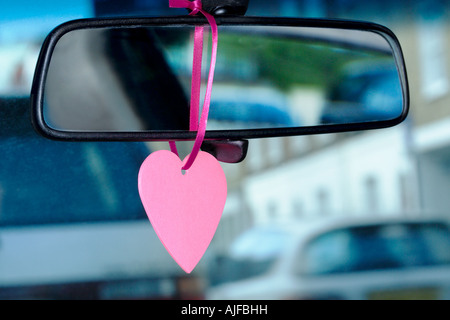 A trinket hanging on a rearview mirror - Stock Image