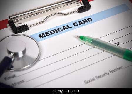 Doctor's stethoscope on the medical form - Stock Image